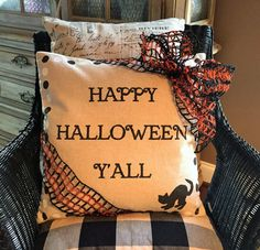 Happy Halloween Y'all reversible linen pillow has a different holiday message on the other side for twice the fun and decorating.