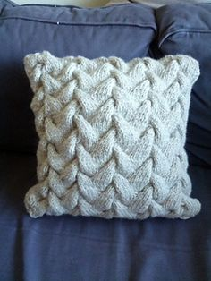"I used the ""Sculpture Pillow"" pattern from Rowan. Unfortunately, the pattern seems to be no longer available online. :-( I used a double strand of yarn, and I reduced the pattern to fi..."