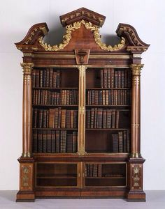 """1740 British Bookcase at the Victoria and Albert Museum, London : Curators commented """"The cabinetmaker John Channon supplied this bookcase and its pair to Sir William Courtenay in 1740. They were made for his new library, on the first floor of Powderham Castle, Devon. The technique of inlaying brass into veneers of wood was fashionable in London between about 1735 and 1760. John Channon, who worked in London, is the best-known maker who used this technique."""""""