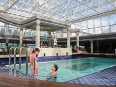 On the world's largest cruise ships, Oasis of the Seas and Allure of the Seas, the two-deck, semi-enclosed space in the bow is outfitted with a pool and various whirlpools.