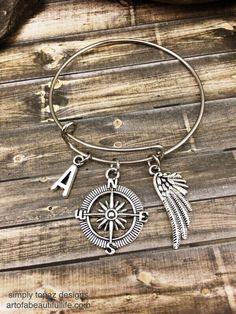 Wanderlust Personalized Jewelry, Personalized Bracelet, Letter Charm, Initial Charm, Compass Jewelry, Custom Jewelry, Wing Jewelry, Wing Bracelet ...by simply topaz | https://www.etsy.com/listing/254239450/personalized-jewelry-personalized