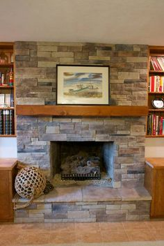 Keep moldingcasing around fireplace but maybe replace the tiles