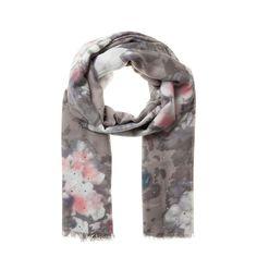 Codello lässt Sie strahlen! Funkelnde Silbersteinchen gehen mit pastelligen Blütenkelchen eine spannende Liaison ein. Der Schal ist ein wahres Highlight für Ihre Tüchersammlung! Material: 100% Polyester...