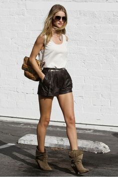 Rosie Huntington-Whiteley is the epitome of cool in her shorts, white tank, and booties