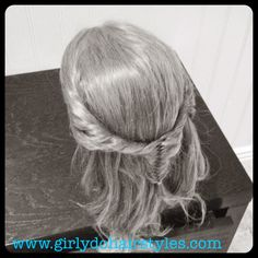 http://www.girlydohairstyles.com/2014/08/fishtail-twisted-pull-back.html