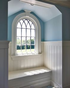 Gothic style window in an attic alcove - light blue and white makes the space inviting and fresh.