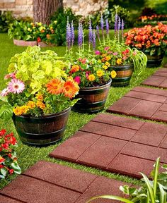 Add a rustic touch to your garden with this Set of 4 Barrel Planters. The large planters have a wood look but are made of sturdy polypropylene for less maintena Large Backyard Landscaping, Backyard Garden Design, Landscaping Ideas, Modern Backyard, Desert Backyard, Landscaping Shrubs, Florida Landscaping, Big Backyard, Landscaping Software