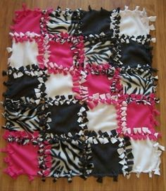 Cool tie no sew blanket. . . Would love to try to make this design. . .