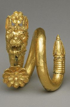 Gold and copper alloy spiral earring with lion-griffin head terminal Period: Classical Date: 1st half of the 4th century B.C. Culture: Greek, Cypriot Medium: Gold