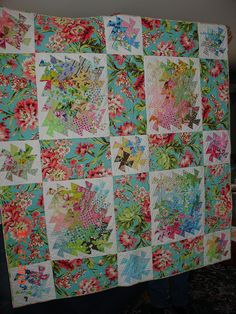 This is different!  Make twister blocks mounted on solid blocks, and then separate them with a floral fabric.  Hmmmmm....!