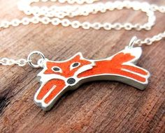 Super cute (and dainty) red fox necklace from Lulu Bug Jewelry. Perfect for adding some sass to a suit.