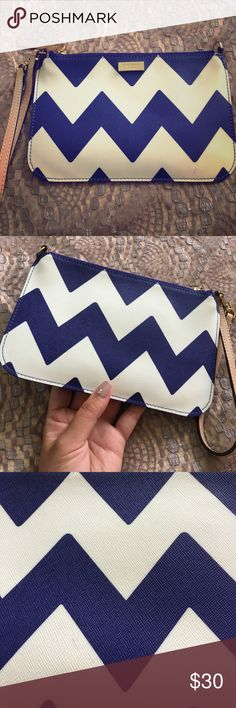 Chevron Kate Spade wristlet Cute blue and white chevron print wristlet for your everyday! Used a few times only. Some light transfer of the blue onto the white reflected in the price. A great size to fit your phone, keys and cash. kate spade Bags Clutches & Wristlets