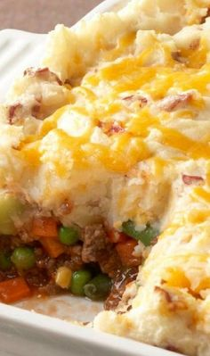 Sheppard's Pie/ 6serv 1-1/4 lb potatoes 3 cloves garlic 1 lb grnd beef 2 T flour 4 C frozen mixed vegetables (carrots, corn, green beans, peas) 3/4 C beef broth 2 T ketchup 3/4 C Sour Cream 1/2 C Sharp Cheddar Cook potatoes/garlic 20 min/tender. brown meat in skillet. Stir in flour; cook 1 min. Add vegetables, broth & ketchup; cook 5 min. Heat oven to 375. Drain potatoes; Add sour cream; mash until potatoes are smooth. Stir in 1/4 cup cheese. Bake 18 min Top with cheese; bake 2 min