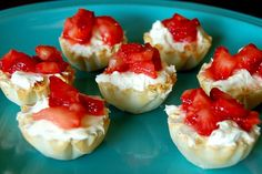 Easy, No Bake Mini Cheesecake Bites-  Ingredients needed:  For the strawberry topping:     2 cups of strawberries, chopped     1/8 cup of sugar  For the Cheesecake Bites:     1 package of reduced fat cream cheese softened     1/3 cup of sugar     1 tsp of vanilla     3/4 cup of cool whip lite 30 mini fillo shells     Add the strawberries to the top of the filling, just before serving