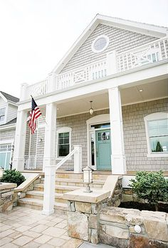 putty colored shingles, white trim, aqua door and garage = LOVE!