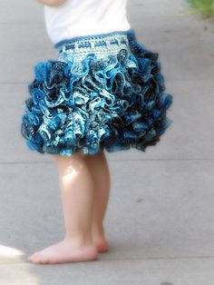 Ravelry: Ballerina Ruffle Skirt pattern by Briana Olsen.cute idea for the ruffled yarn other than scarves So cute! Someone make one for my baby girl PLEASE? Ruffle Yarn, Crochet Ruffle, Crochet Skirts, Ruffle Skirt, Cute Crochet, Crochet For Kids, Crochet Crafts, Crochet Clothes, Crochet Baby