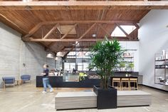 Douglas fir beams punctuate the ceiling, large, industrial-style windows bring natural light to the back of the building, and exposed concrete runs throughout, providing a nod to its history.