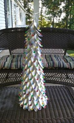 Christmas tree made of plastic spoons painted silver and added beads. This would be fun for older kids to do.DIY Plastic Spoon Crafts - TablepieceYou will need:Plastic spoonsBeadsStarGlue Christmas Tree Crafts, Noel Christmas, Xmas Tree, Christmas Projects, All Things Christmas, Winter Christmas, Holiday Crafts, Christmas Ornaments, Plastic Spoon Crafts
