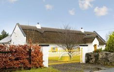 This idyllic Irish cottage has been turning heads Moving To Ireland, Dublin Ireland, Half Doors, Irish Cottage, Modern Cottage, Thatched Roof, Kingdom Of Great Britain, Republic Of Ireland, Old Houses