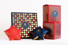 ROKO Studio has designed 2/3 Dolci's Christmas collection of gourmet gifts inspired by traditional Italian patterns. Festive colors of blue and red adorn the paper boxes that gleam with an added touch of gold.