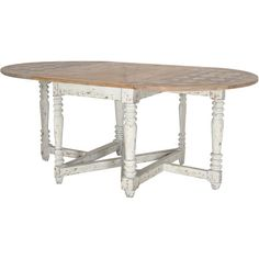 Reclaimed pine wood dining table with turned legs.   Product: Dining tableConstruction Material: Reclaimed pine w...