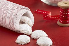 Vanilla shortbread rolled in snowy sugar for a perfect holiday treat.