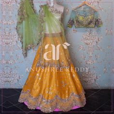 A burst of tangerine in perfect tune with a drape of lime green from Anushree  Reddy. 11 April 2017