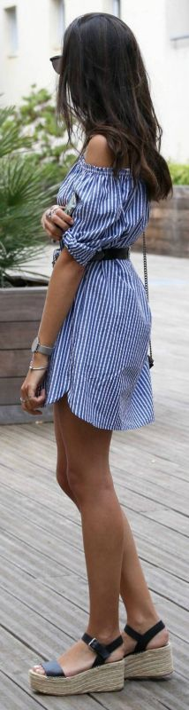 Federica L. + cute and relaxed style + classic blue and white striped pattern + loose fitting off the shoulder dress + belt to clinch in the waist + defined silhouette + simplicity + off the shoulder style.   Dress: Zara, Espadrilles: Stradivarius.