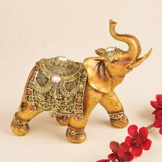 Features:  -Depicted in ceremonial dress including headpiece, blanket and ankle wraps.  -Golden good luck decorative elephant.  -Hand painted in a metallic gold brushed finish with red and silver circ