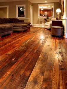 Wide planked recovered wood floors.