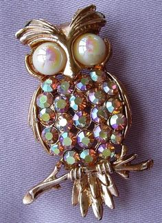 This lovely, quality brooch is in the form of a cute owl perched on a branch. It is made from embossed and pierced metal with a goldtone finish.