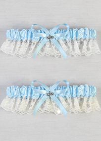 A traditional and elegant blue satin and lace garter adorned with a 2014 silver-tone charm.  View Charm Close Up