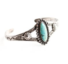 Vintage Sterling Silver Turquoise Cuff Bracelet - Small Size Signed Native American Jewelry / Tribal Teal. $50.00, via Etsy.
