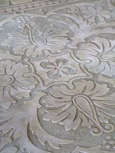 Stenciled plaster for table tops