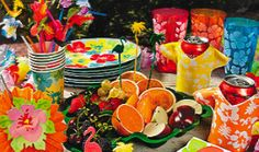 For a Luau, place mini Hawaiian shirts on soda cans/bottles and go with bright colors for flowers and food