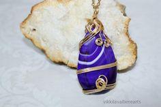 Vikkilavallierearts - Craft Cafe http://craftcafe.co/shop/vikkilavallierearts.php?viewproduct=41882  Purple Twirl Necklace $25.00