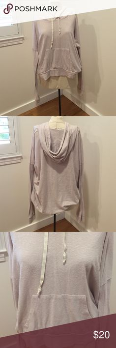 Brandy Melville hoodie with pocket Brandy Melville hoodie with front pocket and neck strings. Soft pale lavender type color. Soft and oversized. Make me an offer! No trades! Brandy Melville Tops Sweatshirts & Hoodies
