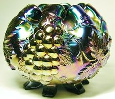 """To price this item and view our other outstanding offerings, we invite you to visit our online store located at http://www.longbrookantiques.com  or  See the wonderful items for sale in our eBay Store user name longbrookantiques2  DUGAN CARNIVAL GLASS BLACK AMETHYST GRAPE DELIGHT FOOTED ROSE BOWL. A very, bold, and colorful rainbow iridescent finish. Measuring 5 1/4"""" X 4"""". No chips, cracks or repairs."""