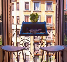 """The Balcony Desk simply clips onto balcony railings with a diameter of 2.4"""" and voila, instant extra space."""