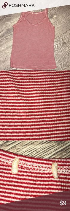 Brandy Melville striped tank top Tiny red and white tiny striped supersoft tank top.  My daughter cut the tag out but everyone that knows Brandy will know this is a Brandy shirt Brandy Melville Tops Tank Tops