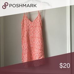 Sundress White and orange sundress that is loose and flowy and has a strap in the back that forms well to the back Mimi Chica Dresses Mini