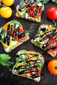 Avocado, Tomato, and Goat Cheese Toast Recipe on twopeasandtheirpod.com Avocado toast with tomatoes, goat cheese, arugula, basil, and a drizzle of balsamic glaze. The perfect avocado toast for summertime.