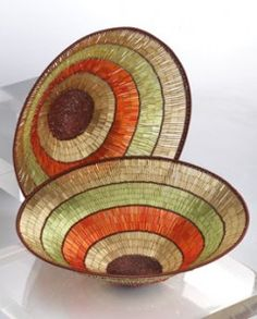 Africa | Beaded glass beads and coppery wire baskets from South Africa.