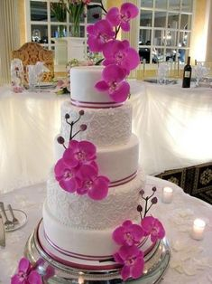 Love this cake too.  You can see with orchids, less is generally more and the pop of color and a white or ivory cake are all you need to make your cake get the oohs and aahhs you had hoped for!