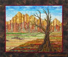 Cathy Geier's Watchman. Strip pieced southwestern landscape quilt with appliqued tree.