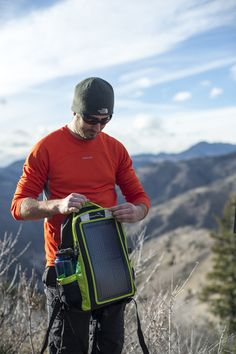 Checking inside his EnerPlex Packr Solar Backpack, this man knows his Smartphone is going to have plenty of charge.