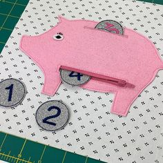 Part two of the kids busy book series is a piggy bank! It's a fun way to teach numbers and fine motor skills.   #sewingtutorial