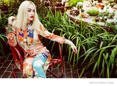 Rita wears funky floral prints for the fashion feature.