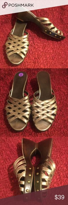 Stuart Weitzman Strappy Bronze Wedge Sandal 8 EUC Really more of a bronze color. Worn rarely & condition reflects. Beautiful, comfy, and excellent quality. Made in Spain, 2' heel. I have TONS more high end & designer items to list so please check out rest of my stuff! The more you buy, the better the deal! Smoke free pet free home! Thanks for looking! Stuart Weitzman Shoes Sandals
