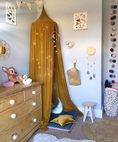 Girls whimsical vintage inspired grey bedroom with numero 74 mustard gold canopy and lots of Lala loves decor products and pretty things from small independent shops. #girlsbedroom #interiordesign #kidsinterior #kidsdecor #vintagestyle